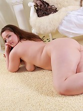 Chubby brunette candy plays with...